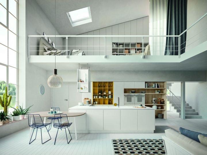 Composizione bianca moderna in contesto loft, tra le soluzioni cucine di tendenza