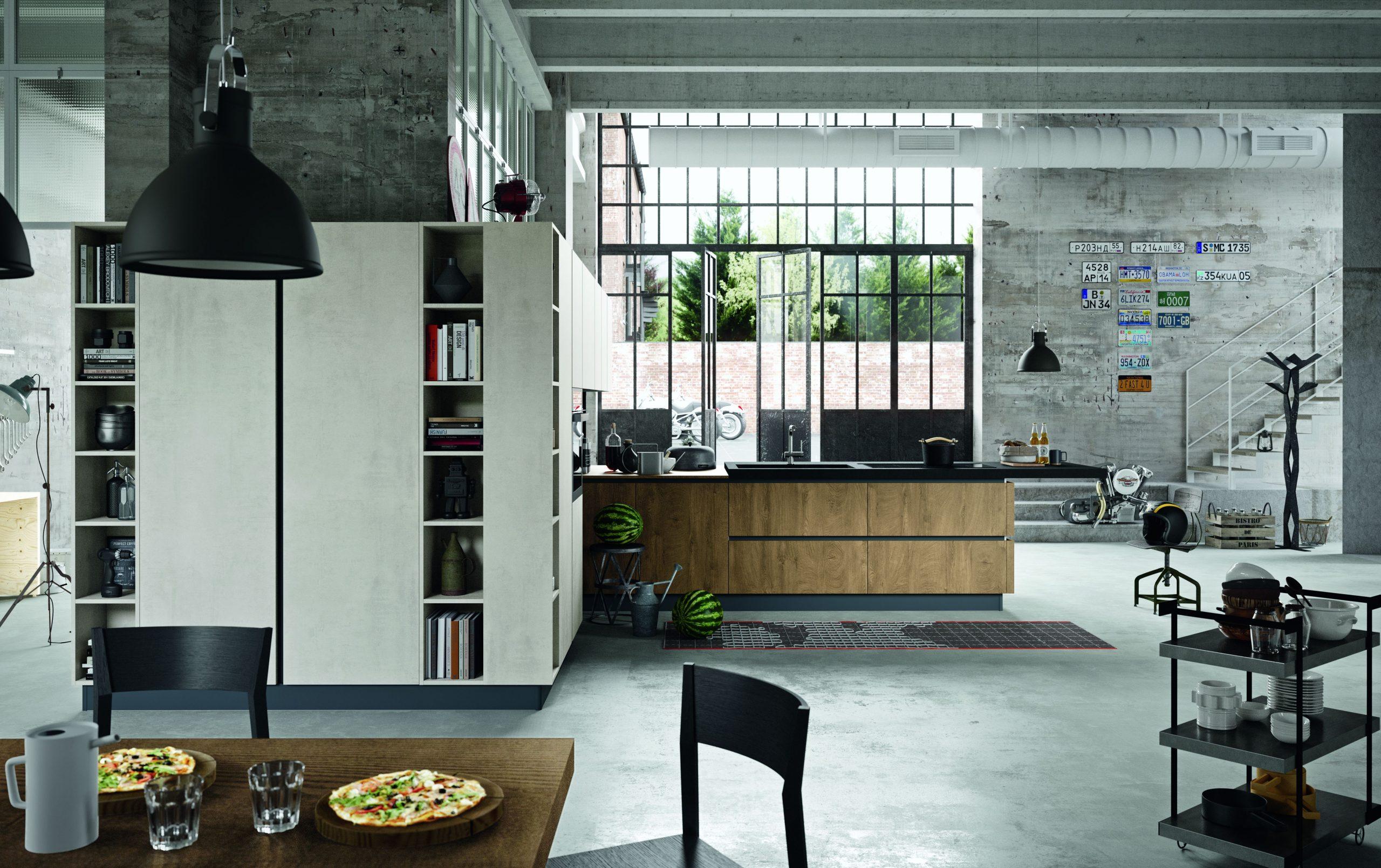 composizione cucina open space in perfetto stile industrial in un unico grande spazio vengono condivise tutte le funzione della zona giorno