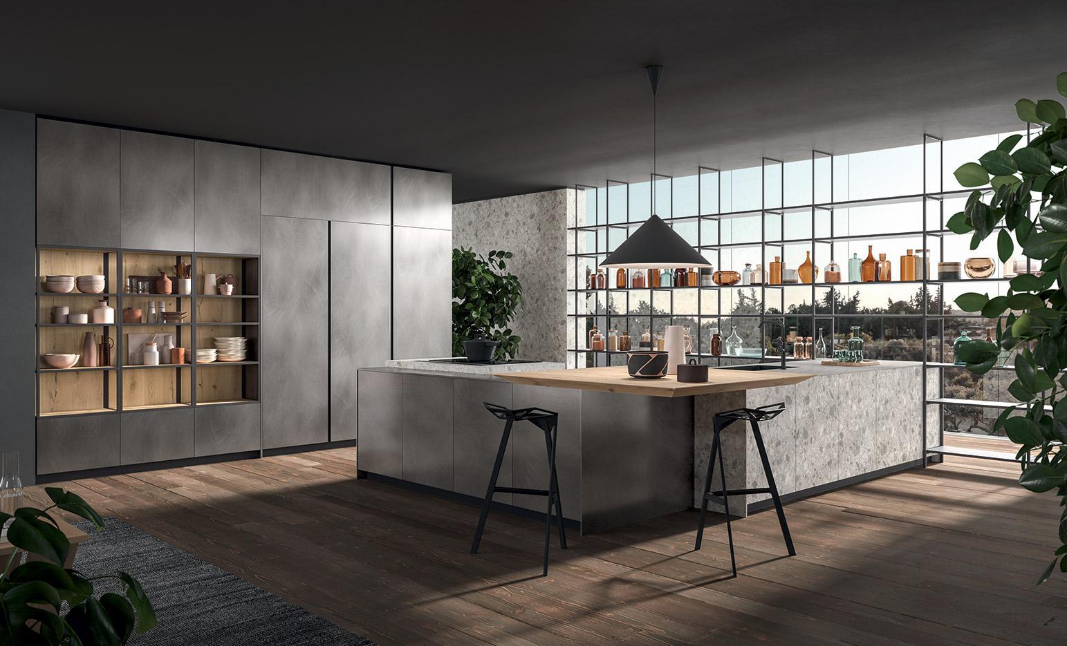 Composizione cucina moderna della serie cucine XXL che si caratterizza per la serie di colonne a parete e importante isola a centro stanza